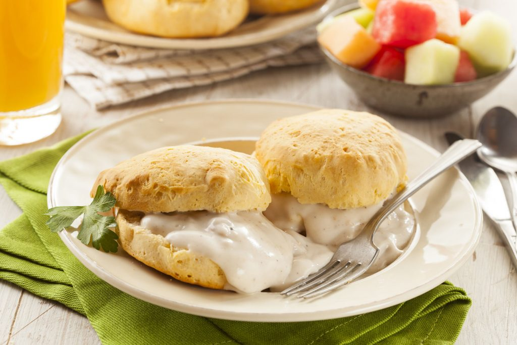 25522910 - homemade buttermilk biscuits and gravy for breakfast